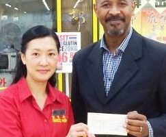 Eva of Wing Yip Wing and Andrew of the GLFB at cheque-presentation