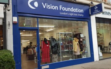large shop window and Vision Foundation sign for Kensington High Street