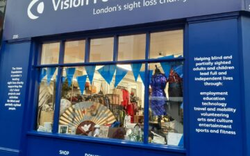 decorated shop window and text panels on outside of Portobello Road Vision Foundation shop
