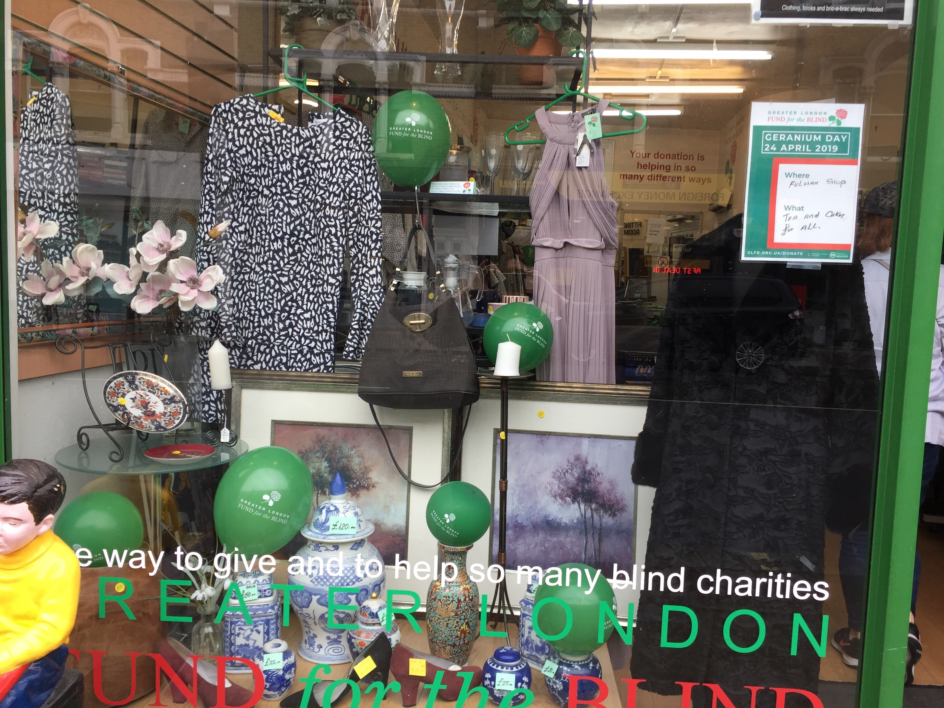 Greater London Fund for the Blind Geranium Shop front with balloons and fundraising posters