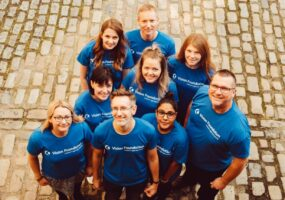 group picture of Vision Foundation staff in matching blue t-shirts