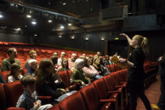 children and families sit in the theatre stalls for a presentation