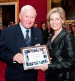 The Countess of Wessex presents a certificate of appreciation to Sir Donald Gosling