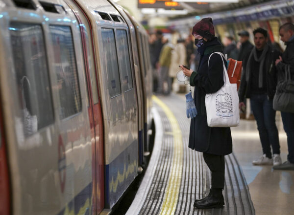 Passenger on the London Underground wears a surgical mask during the coronavirus pandemic.