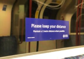social distance sign inside a tube carriage