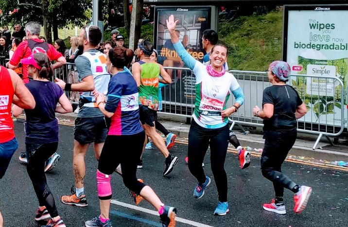 One of our Team Vision Foundation Runners, Erika, waving during a race
