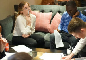 Image shows a group of blind and partially sighted graduates at an employment workshop funded by the Vision Foundation.