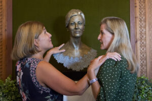 Vision Foundation's Appeal Manager, Monica Smith, feeling the tactile sculpture to learn what HRH The Countess of Wessex looks like. HRH has guided Monica's right arm to her own shoulder to compare the height of the sculpture with her actual height.