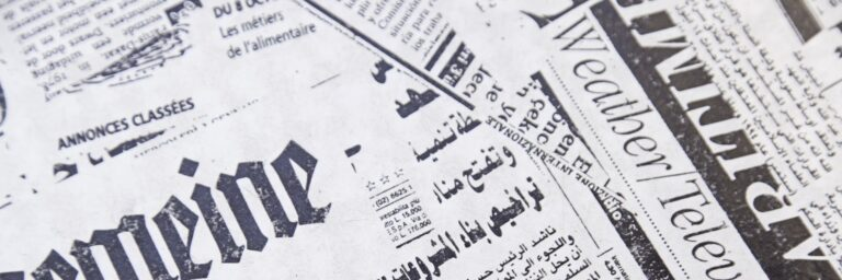 A close up image of a newspaper headline