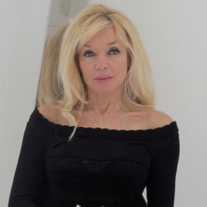 Frances Segelman in a black, bardot style dress